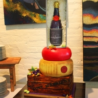 Wine And Cheese Themed Wedding Cake This is a wedding cake with the wine and cheese theme. It stands over 30 inches tall and was made with all edible materials, gumpaste,...