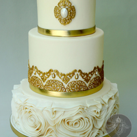 Golden Wedding Cake With Floral Ruffles This is a gold themed wedding cake for a golden anniversary!
