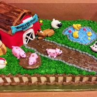 Farm Cake For One Year Old Barn made out of rie krispie treats, animals made out of fondant, cake covered in buttercream.
