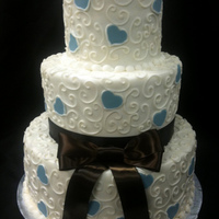 Off White -Blue And Brown Ribbon Wedding Cake