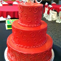 Red Wedding Cake Vanilla and chocolate cake with Red buttercream frosting, red scrolls and red pipping.