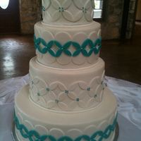 White-Turquoise Wedding Cake Vanilla cake with white chocolate mousse filling, buttercream frosting and fondant decorations, wedding cake.
