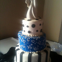 White- Blue- Black Fondant Wedding Cake Vanilla cake with white chocolate mousse filling, Fondant and fondant decorations.