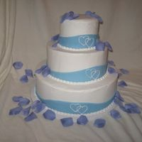 My 1St my 1st wedding dummy cake... buttercream icing w/ fondant ribbon