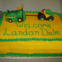 John Deere Baby Shower Cake Tractor And Trailer Were Rice Krispy Treats Covered In Fondant Fondant Baby Amp Blanket Cake Covered With B John Deere baby shower cake. Tractor and trailer were rice krispy treats covered in fondant. Fondant baby & blanket. Cake covered with...