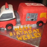 Firetruck Birthday For my son's 4th birthday. Totally his request. Chocolate cake with marshmallow fondant. Cake carved from 3 4x6 cakes...what I cut off...