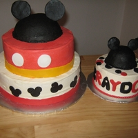 Mickey First Birthday One tier chocolate, one tier vanilla, smash cake vanilla, all covered in buttercream with fondant accents. I used a small half ball shaped...