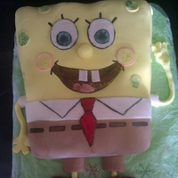 Spongebob Made this cake with my best friend when she got Carpal Tunnel. Super tasty! Silver White cake, filled with pastry creme filling, BC, and...