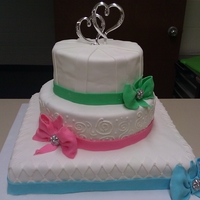 Pretty Little Bow Wedding cake for a friend's candy-color themed wedding. Chocolate cake on the top and bottom tiers, White cake on the middle tier. All...