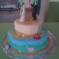 Beach Wedding Wedding cake for a friend. Fondant accessories, graham cracker used for sand.