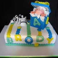 Baby Boy In A Box 2 layer Italian Cream, RKT box, fondant with tylose head and baby converse, and fondant buttons. TFL