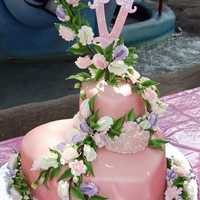 "Victoria's Princess Cake Heart shaped tier cake with sweet peas, tiara and letter ""V"""