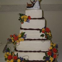 Country Wedding Five tier BC wedding cake. GP flowers are to look like wildflowers in the bride's colors to resemble the bouquets. Chocolate fondant...