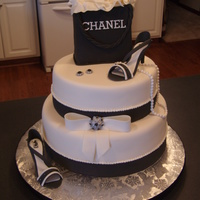 Chanel Birthday Fondant covered with fondant and gum paste details.