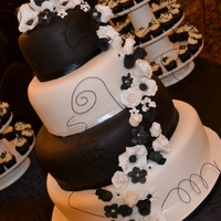 Black And White Wedding Cake Fondant covered with gumpaste flowers. Design inspired by so many on CC. TFL
