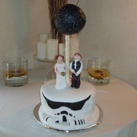 This Was A Cake For The Star Wars Loving Groom With A Storm Trooper Cake And Princess Leah And Hans Solo And The Death Star Spraying Sparkl... This was a cake for the Star Wars loving Groom. with a storm trooper cake and Princess Leah and Hans Solo and the Death Star spraying...