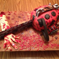 Evil Dead Chainsaw Cake Evil Dead Chainsaw Cake Chainsaw motor is cake, with a Gum Pase Blad and Chain. Hand is fondant.