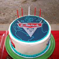 Cars 2 Cars 2 cake for my son's 5th birthday. Used the movie poster for inspiration. Vanilla cake, blueberry filling with swiss meringue...