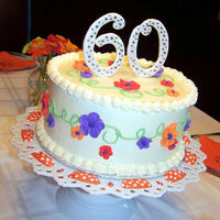 60Th Birthday Dark chocolate cake with swiss meringue buttercream for my mother in law's 60th Birthday.The flowers are made from royal icing and...