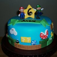 Super Mario Birthday Cake This was a while back...almost a year for my son's 6th birthday. The cake was white with strawberry vanilla buttercream filling....