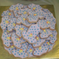 Duck Onsie Cookies These were part of a package of a ducky cupcake tower and a baby and ducky cake also. Cookies were Penny's recipe with rolled...