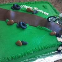 Dirt Bike   chocolate cake with buttercream icing. Got the idea from a CC'er, thx so much.