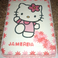 Hello Kitty yellow cake with strawberry filling and vanilla buttercream