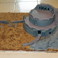 Helm's Deep Lord of the Rings- Helm's Deep. Rocks are made of cereal treats covered in MM fondant. Castle part are made with 10 and 8 in round...