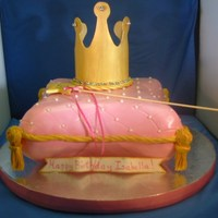 Pillow And Crown Cake vanilla cake, white chocolate ganache, covered in MFF. gumpaste crown and wand.