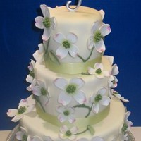 Dogwood Wedding Cake fondant covered cake with sugarpaste dogwood flowers and leaves. Idea from Martha Stewart wedding cake book.