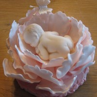 Baby In Pink Peony Baby, peony and butterfly are all made from sugar paste.