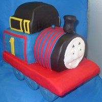 Thomas The Tank Engine Cake Cake made for a charity auction. Vanilla cake, chocolate ganache, and white chocolate fondant.