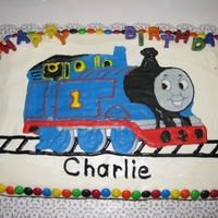 Thomas The Tank Engine Chocolate cake with chocolate filling; buttercream icing; M&M trim; color flow design