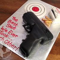 """the Best Shot"" Glock Anniversary Cake This hand-carved Glock pistol anniversary cake is covered in fondant and features hand-painted fondant accents and accessories: shells,..."