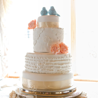 Vintage Lace & Ruffles Wedding Cake This beautiful wedding cake featured design elements especially requested by the bride: lace appliqué, large delicate blooms,...