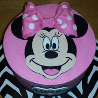 Minnie Mouse Buttercream iced cake with fondant Minnie. Gumpaste bow.