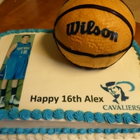 Basketball Cake yellow cake with edible image of birthday boy. the basketball was made with the ball pan.