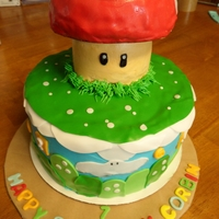 "Mario Brothers Cake 9"" 3 layer yellow cake on the bottom. The mushroom is a 4"" round cake and the top was baked with the ""ball"" pan. It&#..."