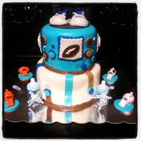 Baby Shower Cake Chocolate and vanilla cake with fondant covering. Sports theme baby shower cake