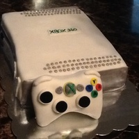 Xbox360 Cake I made this Xbox360 cake using fondant for decor and it was a chocolate cake with buttercream icing. The remote was also chocolate cake...