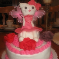Hello Kitty Hello kitty cake for my great neice. Hello kitty is RFT and fondant. Roses are bubble gum. Vanilla cake with a whipped crusting buttercream...