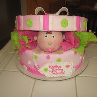 Baby In Gift Box My first time making a cake like this I made the lid out of RKT but it was to heavy for the cake so I had to go to plane B styrofoam lid...