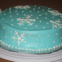 Snowflake Christmas Cake   This is my first attempt at making royal icing snowflakes. As you can tell...I still need a lot of practice! :)
