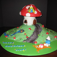Lily's Smurfday Cake!  Our granddaughter loves to play Smurf Village on the Ipad so of course she wanted a smurf cake, Mushroom top is RKT, along with the...