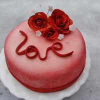 Love Lemon pound cake with lemon curd filling and buttercream icing. Covered in fondant. I made this for my family for Valentines day. The roses...