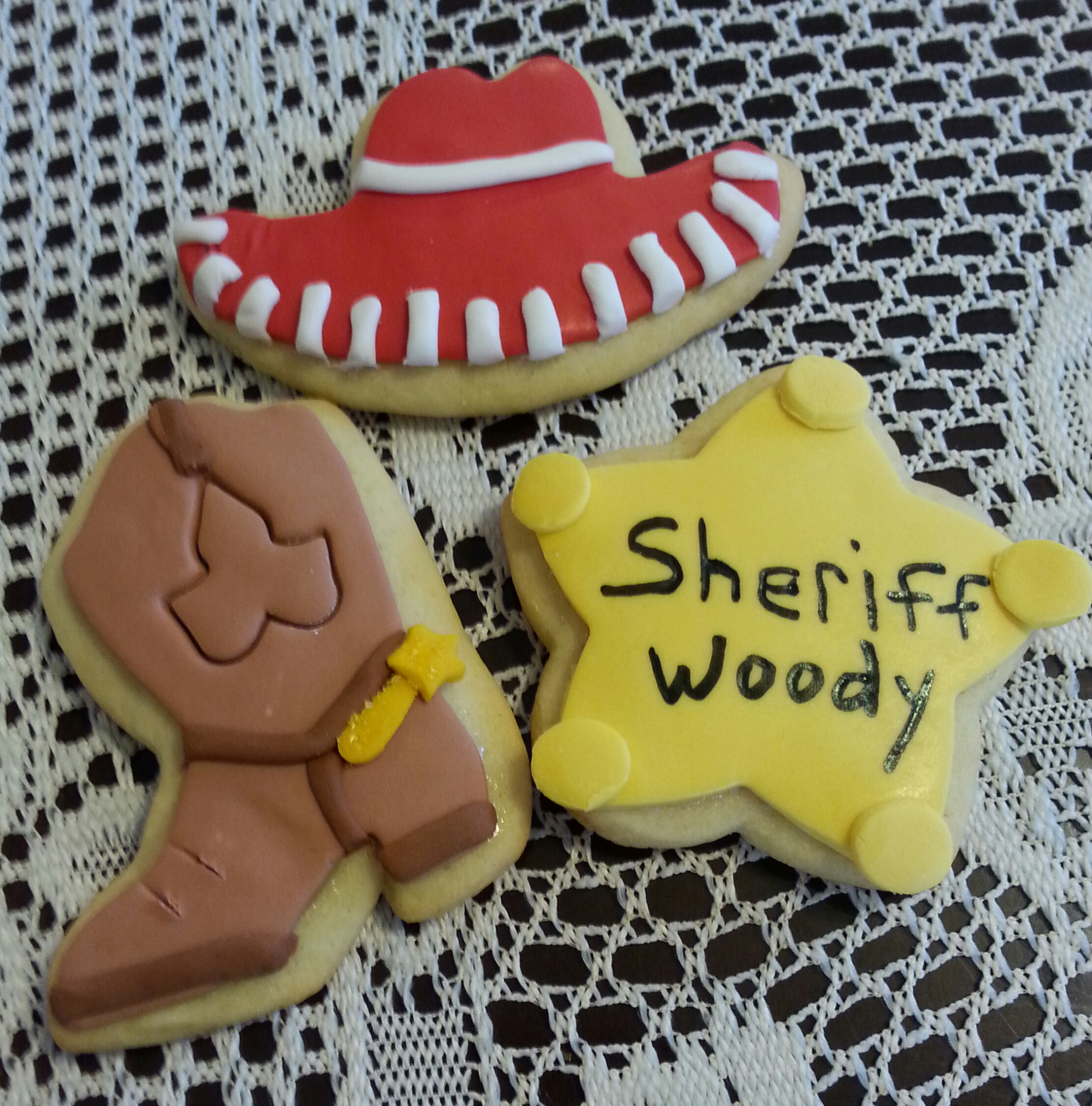 Toy Story lemon sugar cookies. cotton candy rolled buttercream deco.