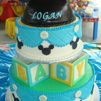 Mickey Mouse Baby Shower Mickey Mouse hat and 2nd tier are chocolate cake with mocha buttercream icing. Hat covered with fondant and gumpaste ears. Block were...