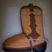 Cowboy Boot Cake Carved boot covered in MMF. This was supposed to be a grooms cake, but the wedding was called off the morning of, so I was very sad that it...