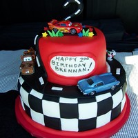 "Cars 2Nd Birthday Cake 10"" and 6"" covered in fondant. with Fondant accents and real cars."