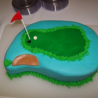 Golf Grooms Cake Carved 11x15 into paisley. Covered in fondant.